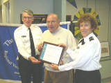 P/C Peter Jenkin, SN, and P/C Nancy Miller, SN, recognize Arthur Ferrucci for fifty years membership.