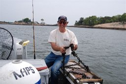 Mark Cisto helps setup the NHPS mooring buoy for summer use