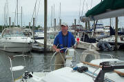 Gil Simmons at the Helm using a horn to notify WTNH viewers that NHPS leads the way in boating safety,
