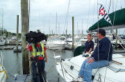 Cdr. Kim Chieppo, P, and Safety Officer Art Andrea , P, provide Channel 8 viewers with tips on boating safety.